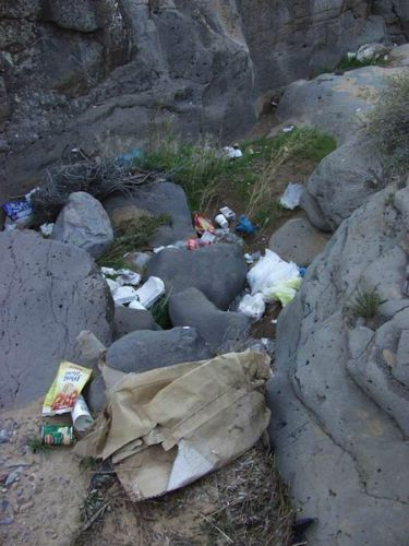 Trash moves through basalt flows in the side arroyo
